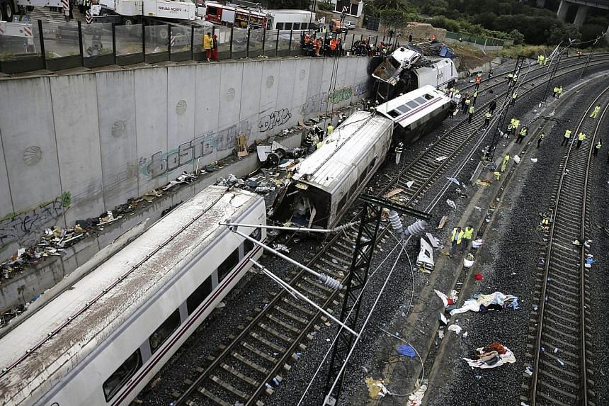Rescuers, forensics and police officers work at the site of a train accident near the city of Santiago de Compostela on July 25, 2013. Spanish police have finished identifying all 78 victims of the nation's deadliest train crash in decades, a c
