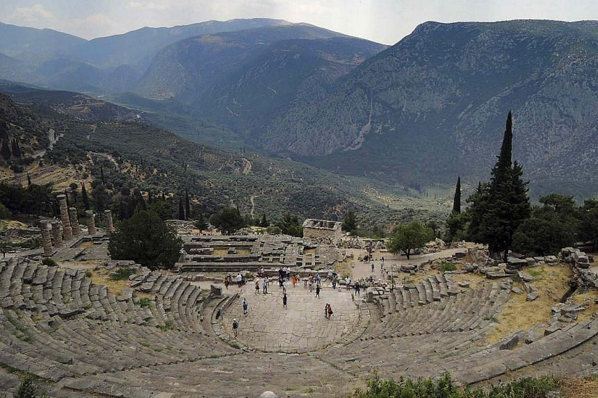 Tourists visit the archaeological site of Delphi some 180km north-west of Athens July 27, 2013.Foreign tourists are finding their way back to Greece's islands and ancient ruins, offering a rare boost to an economy contracting for the sixth year