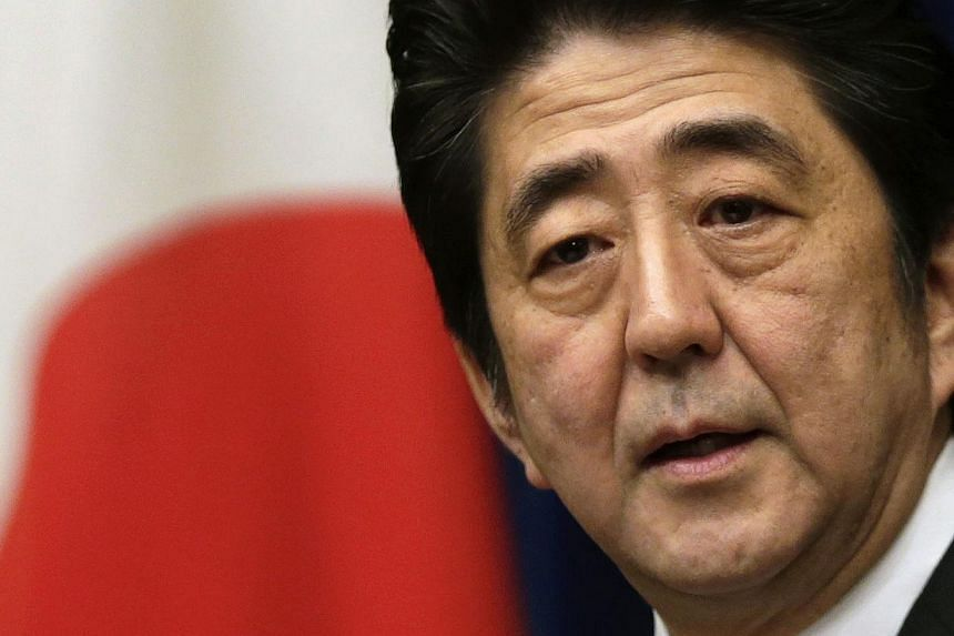 Japan's most significant fiscal reform in years - a planned increase in the country's sales tax - could be delayed or watered down in a move that might rattle financial markets and amount to an own goal for Prime Minister Shinzo Abe (above). -- FILE