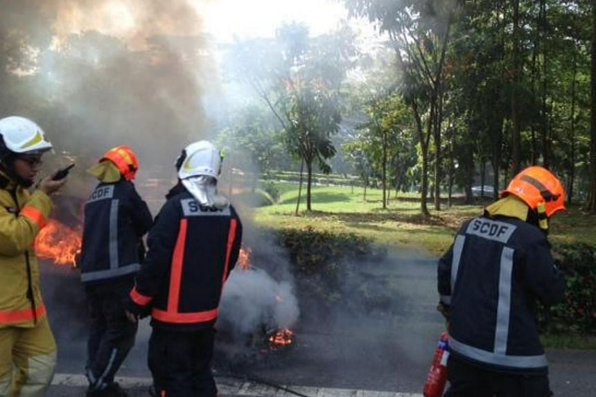 A car caught fire on Sunday, July 28, 2013, along the Pan-Island Expressway, just after the Stevens Road exit. -- ST PHOTO: ZURAIDAH IBRAHIM