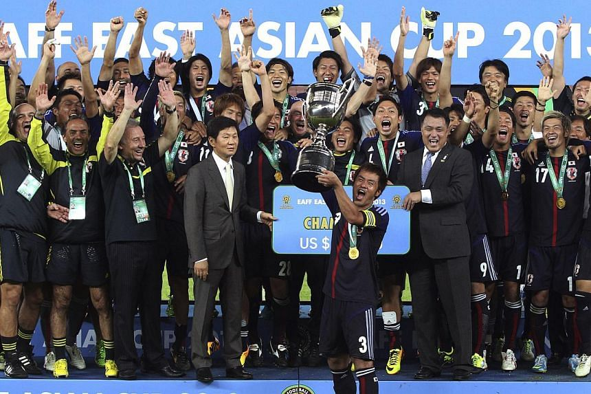 Japan's captain Yuichi Komano holds up the trophy with his teammates after Japan won the East Asian Cup in Seoul, South Korea on Sunday, July 28, 2013. Japan's men claimed the East Asian Cup for the first time on Sunday with a 2-1 win over hosts Sout
