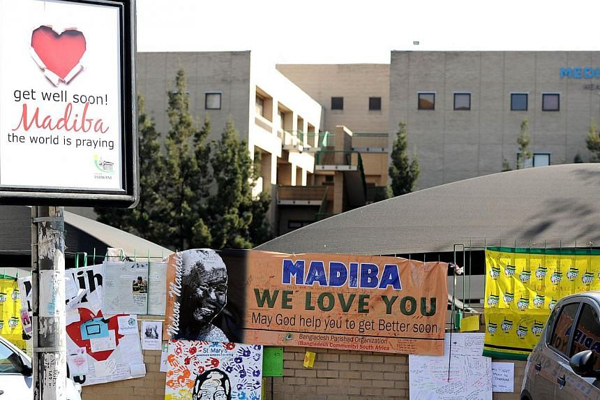 Messages left for former South African president Nelson Mandela outside the Medi Clinic Heart Hospital in Pretoria on July 19, 2013. South Africa's presidency said on Sunday, July 28, 2013, that Mr Mandela was still critically ill in hospital but imp