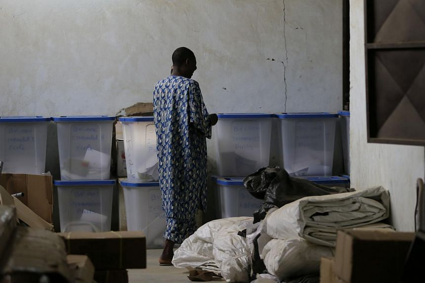 A man stands near ballot boxes in the northern Malian city of Kidalon Saturday, July 27, 2013. Malians defied Islamist death threats to vote on Sunday for a president expected to usher in a new dawn of peace and stability as polling stations op