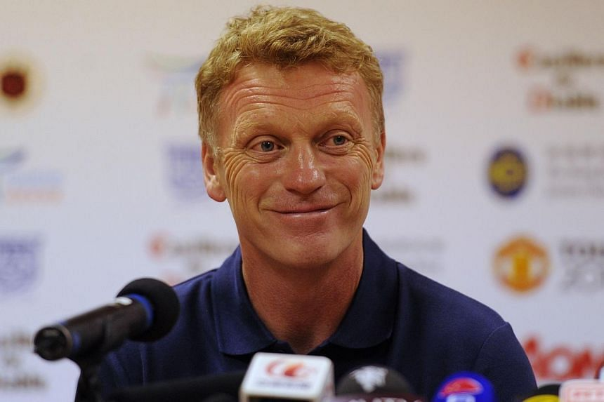 Manchester United manager David Moyes (above) smiles during a pre-football match press conference in Hong Kong on Sunday, July 28, 2013. Moyes on Sunday said he is confident of getting new players in before the end of the transfer window despite the