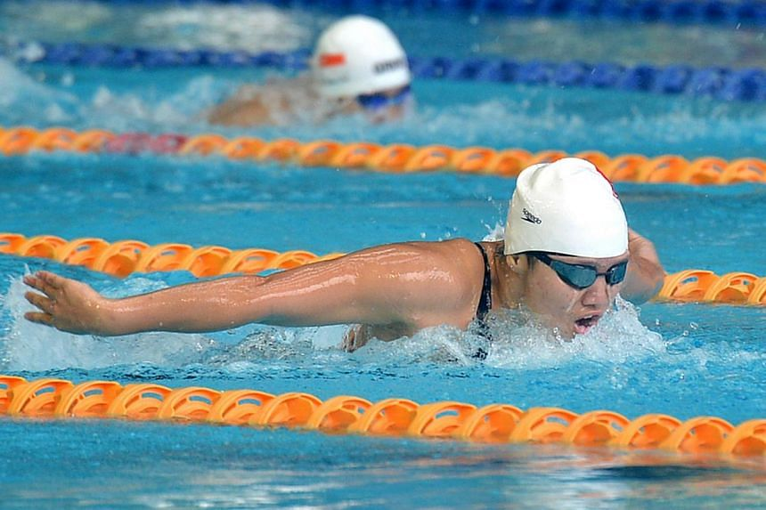 Singapore's Tao Li (above) clocked 58.94sec in the women's 100m butterfly heats at the World Championships in Barcelona on Sunday morning, earning her a semi-final berth. -- TNP FILE PHOTO: JEREMY LONG