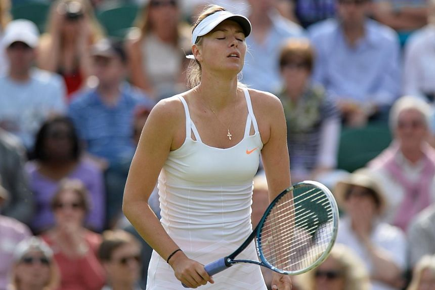 Russia's Maria Sharapova reacts after a point against Portugal's Michelle Larcher De Brito during their second round women's singles match against on day three of the 2013 Wimbledon Championships tennis tournament at the All England Club in Wimbledon