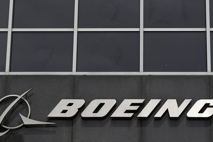 The Boeing logo is seen at their headquarters in Chicago in this April 24, 2013 file photo.Boeing Co asked airlines on Sunday to inspect aircraft worldwide to gather data on Honeywell International Inc emergency beacons that have come und