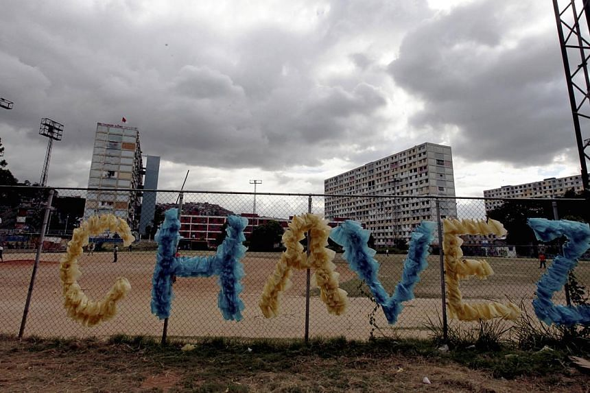The last name of Venezuela's late President Hugo Chavez decorates a fence at a baseball field in the 23 de Enero neighbourhood of Caracas, Venezuela, on Friday, July 26, 2013. Chavez supporters are preparing to commemorate what would have been Chavez