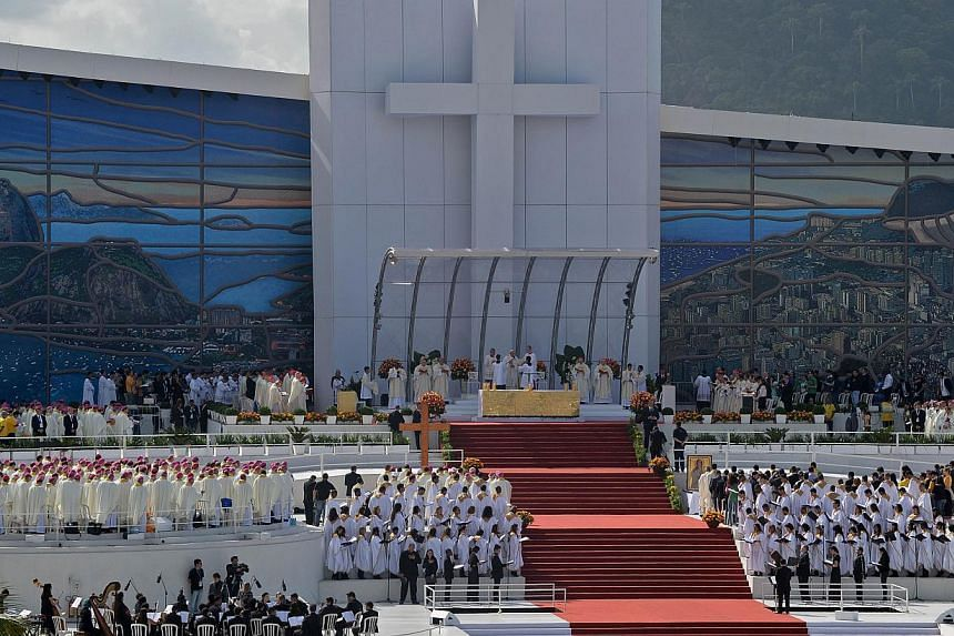 Pope Francis (centre) celebrates the final mass of his visit to Brazil, at Copacabana beach in Rio de Janeiro, on July 28, 2013. -- PHOTO: AFP