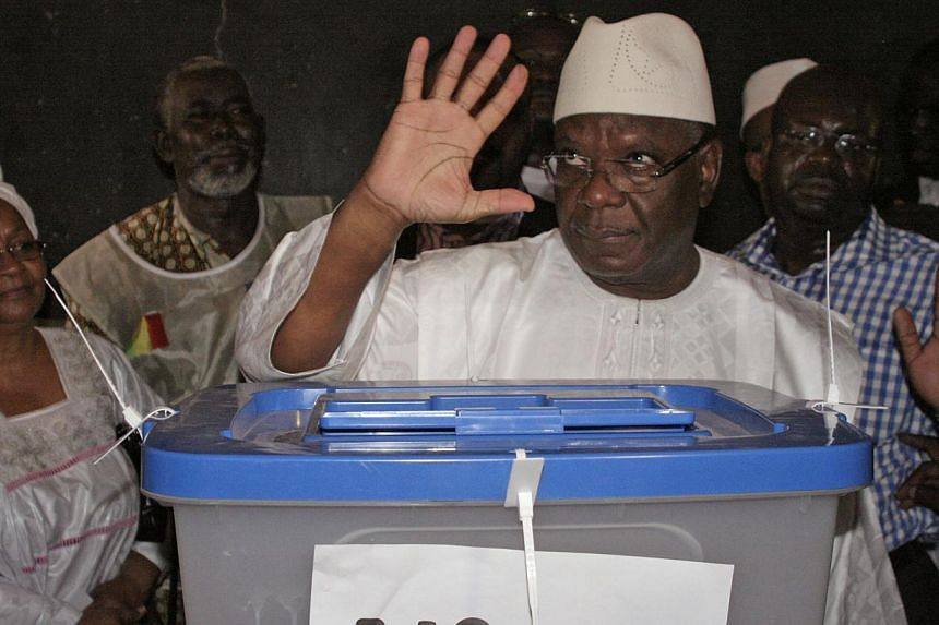 Mali presidential candidate Ibrahim Boubacar Keita gestures after casting his ballot in Bamako, Mali, on Sunday, 28, July, 2013. Preliminary results collated by journalists in polling stations gave a clear early lead to former premier Mr Keita in Mal