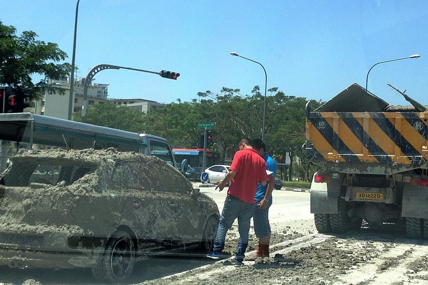 A series of photographs showing a car covered in what appeared to be wet cement has some hawk-eyed netizens wondering: Was it actually mud instead of cement? -- PHOTO: STOMP