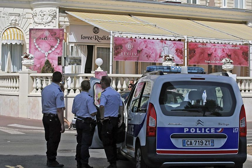 Police outside the Carlton hotel, in Cannes, southern France, the scene of a daylight raid on Sunday, July 28, 2013. -- PHOTO: AP