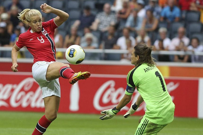 Norway's Elise Thorsnes (left) tries to score past Germany's goalie Nadine Angerer during their women's Euro 2013 final soccer match at Friend's Arena in Stockholm on July 28, 2013. Angerer saved two penalties to help Germany win a record sixth conse
