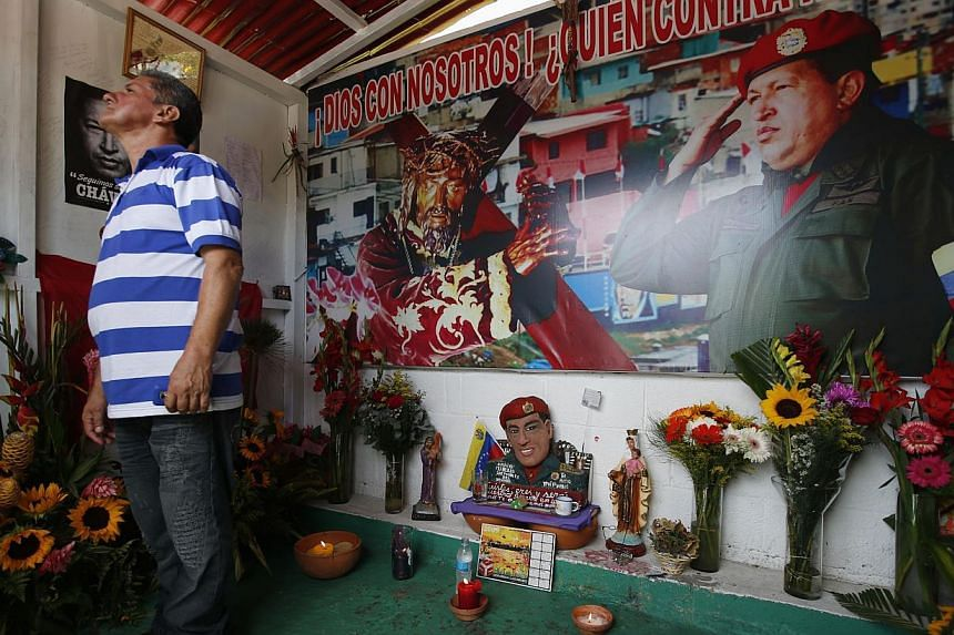 A man stands inside a chapel dedicated to the late Venezuelan President Hugo Chavez, outside his mausoleum in Caracas, on July 28, 2013. Supporters of Chavez gathered in various parts of the country on Sunday to commemorate his 59th birthday, accordi