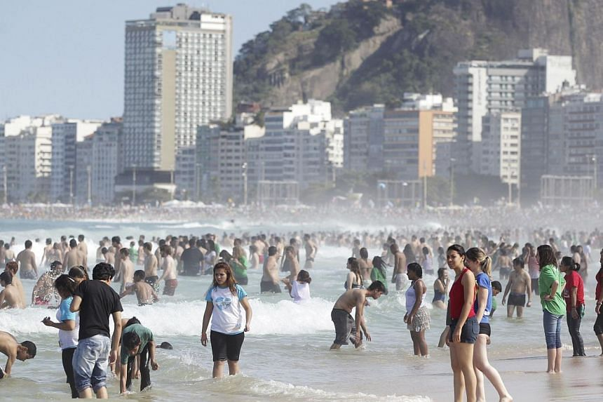Hundreds of thousands crowd the beach after Pope Francis celebrated his final mass on Copacabana Beach in Rio de Janeiro on July 28, 2013. -- PHOTO: REUTERS
