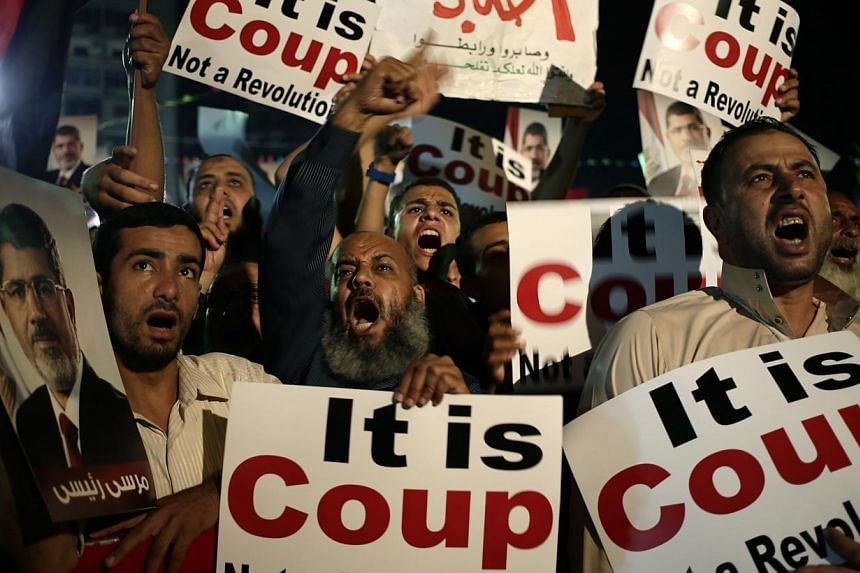 Supporters of Egypt's ousted President Mohammed Mursi chants slogans against Egyptian Defence Minister General Abdel-Fattah el-Sissi at Nasr City, where protesters have installed a camp and hold daily rallies, in Cairo, Egypt, Sunday, July 28, 2013.