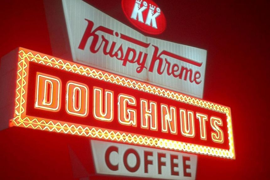 Popular American doughnut chain Krispy Kreme will be opening its first outlet at Tangs in Orchard Road in October. -- ST FILE PHOTO: FRANCIS CHAN