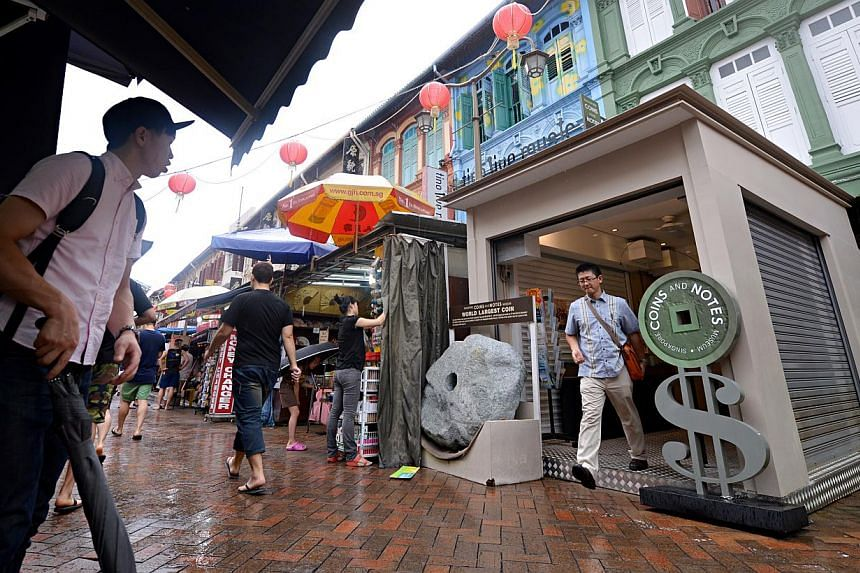 A mock-up of the shelter that will replace the plastic awnings of about 70 street stalls in Chinatown Street Market was erected two months ago outside Singapore Coins and Notes Museum on Pagoda Street. -- ST PHOTO: NURIA LING