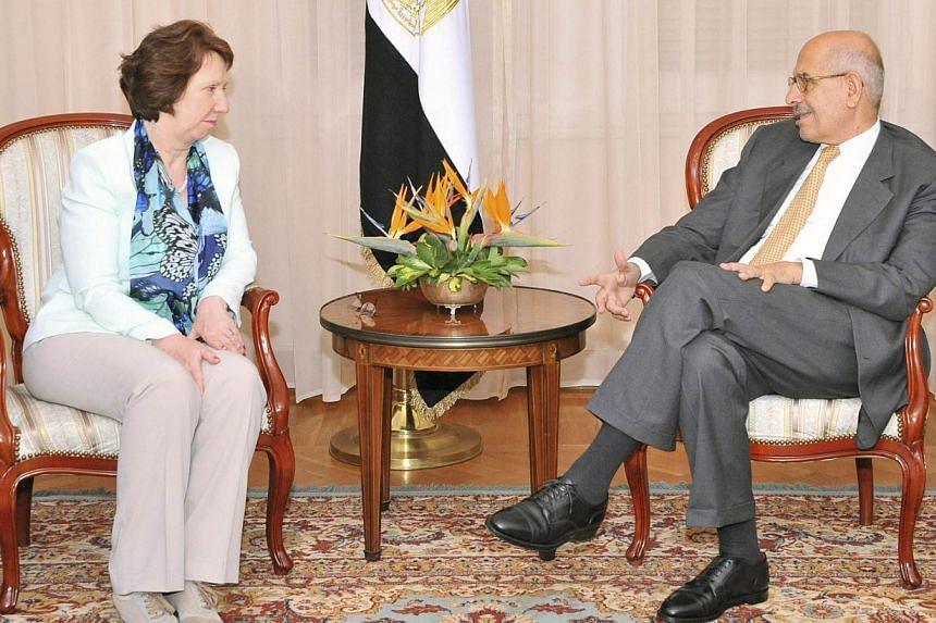 Egypt's interim vice-president Mohamed ElBaradei (right) meets with European Union foreign policy chief Catherine Ashton (left) in Cairo July 17, 2013. EU foreign affairs head Catherine Ashton called again on Sunday for a return to civilian rule in E