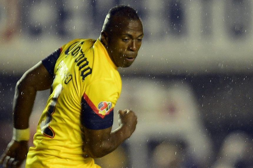 Ecuador striker Christian Benitez (above) has died suddenly in Qatar at the age of 27, his agent Jose Chamorro said on Monday, July 29, 2013. -- FILE PHOTO: AFP