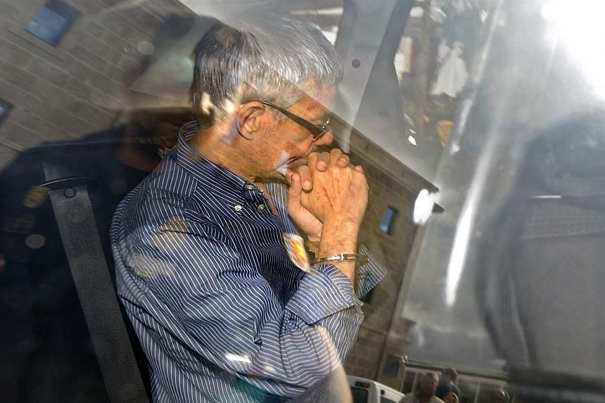Spanish train driver Francisco Jose Garzon Amo leaves the police station to be transferred to the courthouse of Santiago de Compostela on July 28, 2013. -- PHOTO: AFP