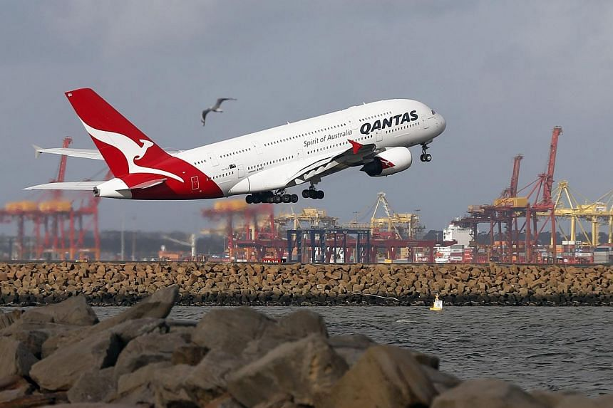 A Qantas plane A380 takes off from Kingsford Smith International airport in Sydney on June 26, 2013. A Qantas flight was forced to divert to Canberra on Monday, July 29, 2013, due to smoke in the cockpit, the Australian airline said. -- FILE PHOTO: R