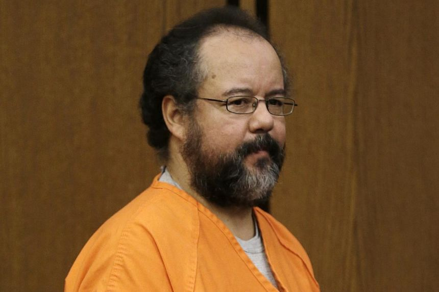 Ariel Castro enters the courtroom on Friday, July 26, 2013, in Cleveland. A life behind bars is just punishment for Castro, who has pleaded guilty to kidnapping three women and holding them as sex slaves for a decade, his son said on Monday. -- FILE
