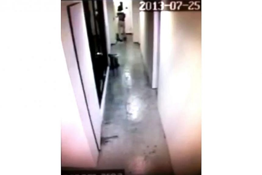 This screenshots are taken from CCTV footage. They show Dr Hannah Tan walking towards the lift door. -- PHOTO:COURTESY OF MR ZURIEL BERNARDINO