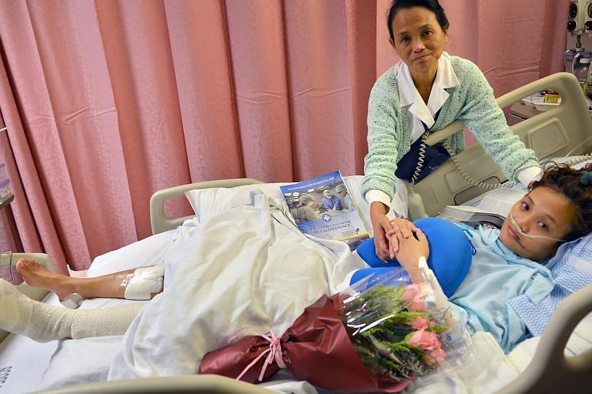 This photo shows Dr Hannah Tan lying in hospital, after falling four storeys in a lift shaft. She suffered four fractured ribs and broken bones in her left foot. She also suffered lacerations to her feet, head and mouth, and had to be stitched up. He
