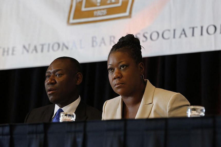 Sybrina Fulton (right) mother of Trayvon Martin, sits with her attorney Benjamin Crump at a news conference at the National Bar Association annual convention in Miami Beach, Florida on July 29, 2013. The mother of Trayvon Martin said on Monday the vo