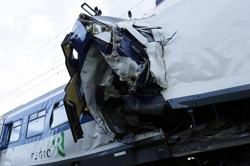A view of the scene where two Swiss regional trains collided head on near Granges-Pres-Marnand near Payerne in western Switzerland on July 29, 2013. The two trains collided in the Swiss canton of Vaud on Monday evening, injuring about 40 people, four