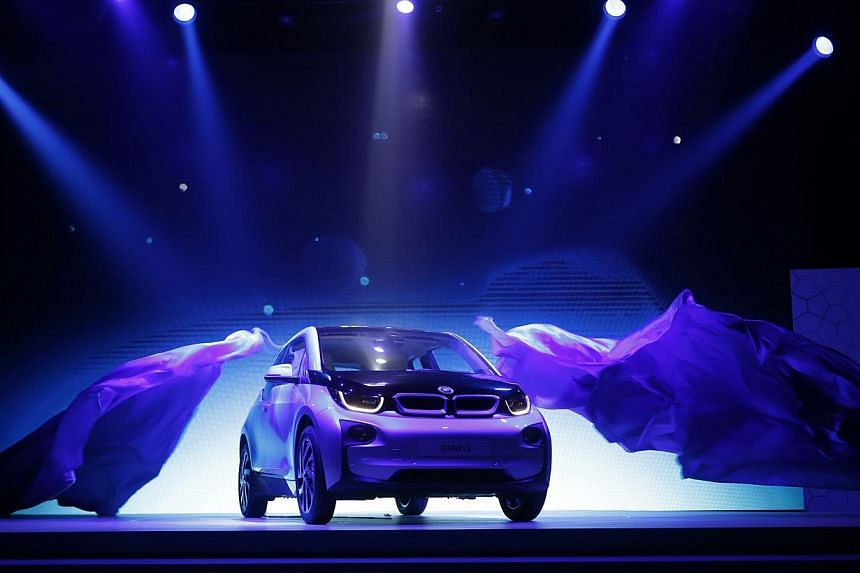 German luxury automaker BMW's first all-electric car, i3, is unveiled at a ceremony in Beijing on Monday, July 29, 2013. BMW will start to sell its new battery-powered i3 compact car next year in China - a market that it predicts will become the top