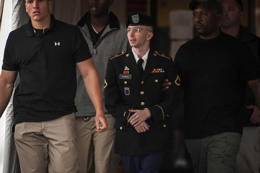 Private First Class Bradley Manning, 25, is escorted out of court after the second day of deliberation in his military trial at Fort Meade, Maryland July 28, 2013.United States / Maryland (AFP) - A verdict is expected Tuesday in the trial of Am