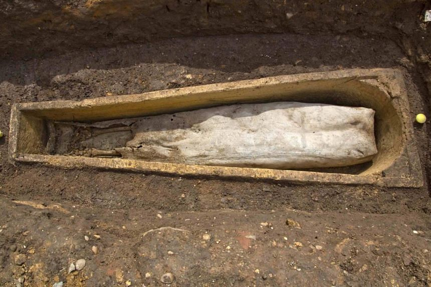 A stone coffin is pictured after its lid was removed at the Greyfriars dig site in this handout photo by the University of Leicester released on July 29, 2013.Archaeologists have discovered a mysterious coffin-within-a-coffin from the same Leic