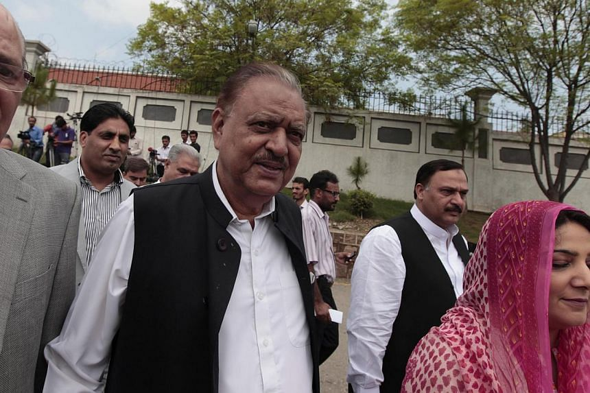 Mr Mamnoon Hussain (centre), presidential candidate of the Pakistan Muslim League-Nawaz (PML-N) party, arrives to submit his nomination papers for the upcoming presidential election at the High Court in Islamabad on Wednesday, July 24, 2013. Pakistan
