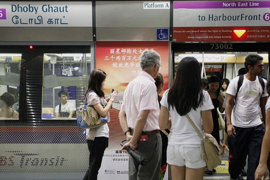 People waiting to enter the train at Dhoby Ghaut MRT station along the North-East line during peak hour on Feb 17, 2012. Train services on the North-East Line towards Harbourfront station were delayed for 25 minutes on Tuesday morning around 9.15am.