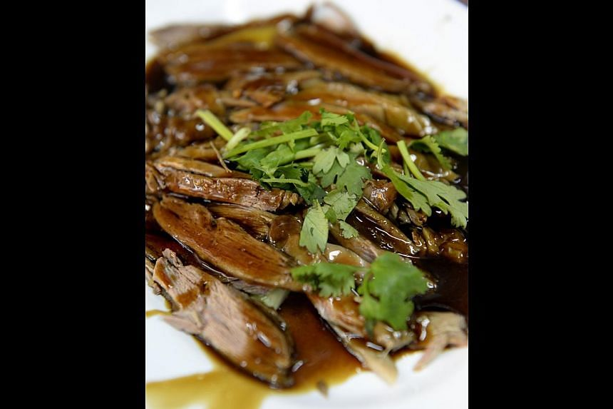 Customers say the duck (above), with its distinctive herbal gravy flavoured with cinnamon, tastes the same as what Lim Seng Lee's founder, Mr Lim Ah Too, served in South Buona Vista Road. -- ST PHOTO: DESMOND FOO