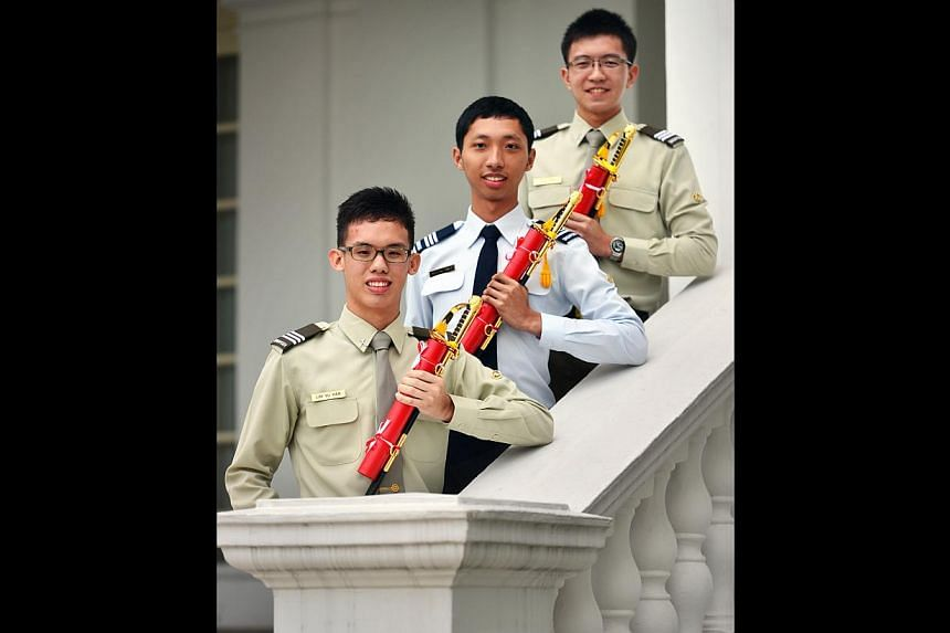 Officer cadets (from left) Lim Yu Han, Maung Thet Naing Win and Jonathan Loh You Qing, all 19, are among eight who received the SAF Overseas Scholarship at a ceremony yesterday.