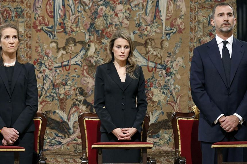 Spain's Princess Elena, left, Princess Letizia, centre and Prince Felipe stand during a funeral mass at the cathedral in Santiago de Compostela, Spain, Monday July 29, 2013. Spain's royal family and leading politicians attended a somber Mass in hom