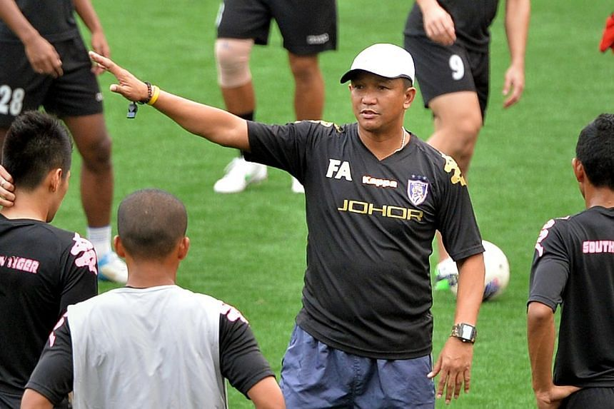 Malaysian Super League side Johor Darul Takzim announced on Tuesday, July 30, 2013, that it had relieved Fandi Ahmad (centre) of his coaching duties. -- TNP FILE PHOTO: ARIFFIN JAMAR