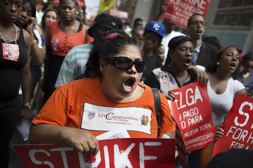Demonstrators in support of fast food workers march towards a McDonald's as they demand higher wages and the right to form a union without retaliation, Monday, July 29, 2013, in New York's Union Square. -- PHOTO: AP