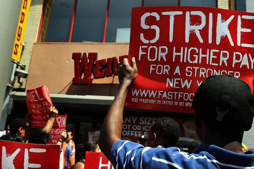 Employees and supporters demonstrate outside of a Wendy's fast-food restaurant to demand higher pay and the right to form a union on July 29, 2013 in New York City. Across the country thousands of low-wage workers are expected to walk off their jobs