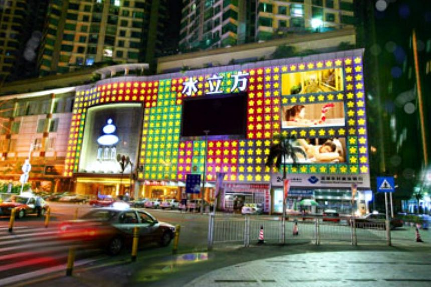 The Water Cube Spa Palace in Shenzhen, a six-storey emporium of services, housed in its own building with a flashing logo on the facade. -- PHOTO: INTERNET