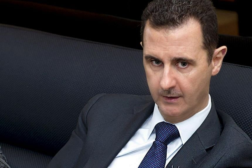 A handout picture released by the Syrian Arab News Agency (SANA) on June 17, 2013, shows Syrian President Bashar al-Assad speaking during an interview with German Frankfurter Allgemeine Zeitung newspaper in Damascus.Syrian President Bashar al-A