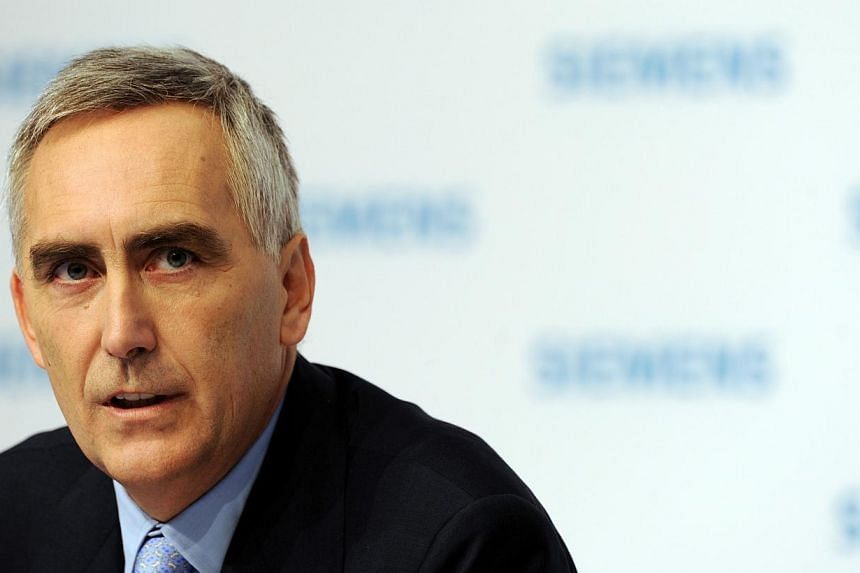 Picture taken on Nov 10, 2011 shows Peter Loescher, CEO of German industrial giant Siemens, attending the company's annual press conference in Munich, southern Germany. German engineering giant Siemens is due to dramatically oust its chief executive