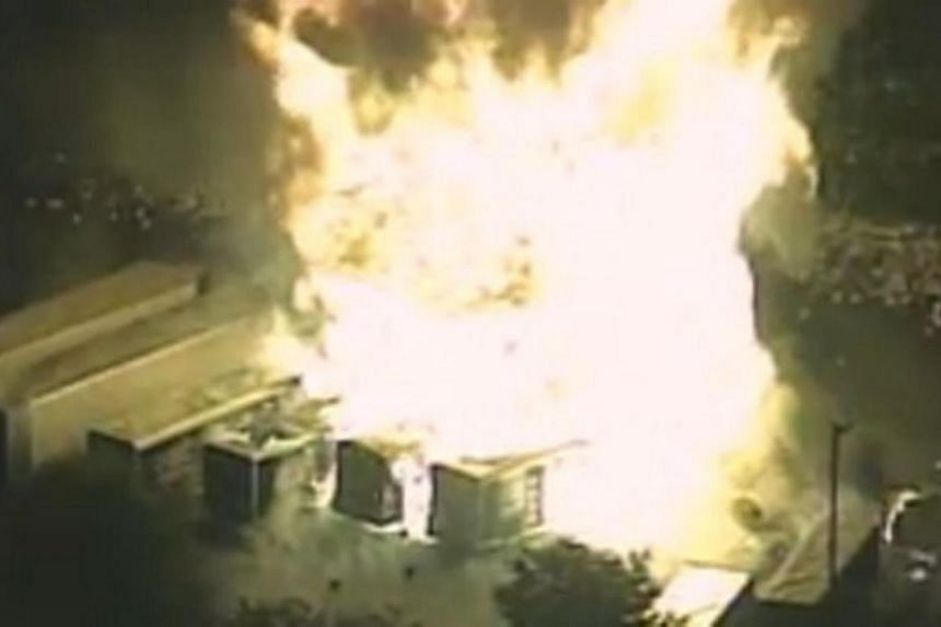 This handout photo released by ClickOrlando.com on July 30, 2013 shows propane tank cylinders explosions at the Blue Rhino plant in Tavares, central Florida late July 29, 2013. Fifteen people were unaccounted for and nearby neighborhoods were evacuat