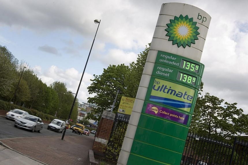 This is a Wednesday, May 15, 2013 file photo of vehicles as they pass a BP petrol station in Manchester, England. British energy giant BP admitted on Tuesday that its US$20 billion (S$ 24 billion) fund to compensate victims of the 2010 US oil sp