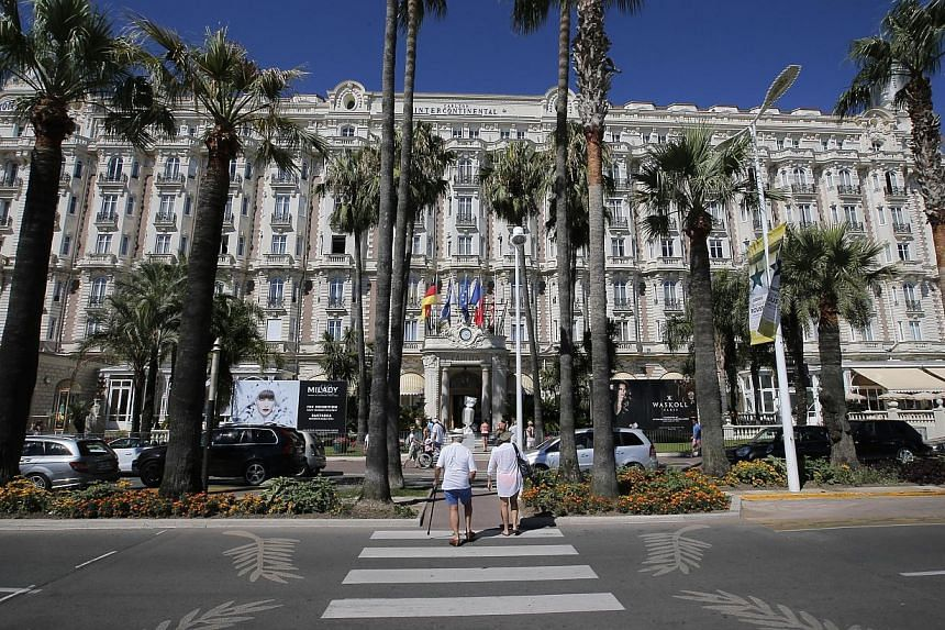 A view of the Carlton hotel, in Cannes, southern France on Tuesday, July 30, 2013, the scene of a daylight raid last Sunday, July 28. Security at the luxury Carlton hotel in the French Riviera town of Cannes is under the spotlight in an investig