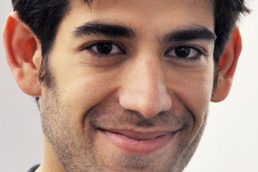 This Dec 8, 2012 file photo provided by ThoughtWorks shows Aaron Swartz, in New York. Massachusetts Institute of Technology on Tuesday issued a report clearing itself of wrongdoing in the suicide of an Internet activist who had been under prosecution