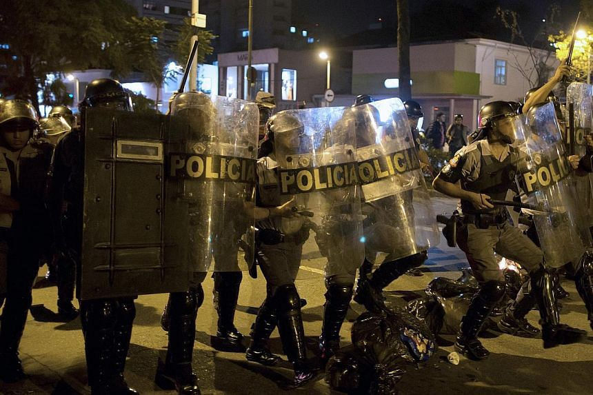 Riot police take confront anti-government protesters in Sao Paulo, Brazil, on Tuesday, July 30, 2013. Demonstrators are demanding better public transit, health and education services. -- PHOTO: AP